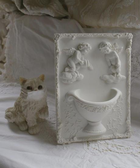 ATQ  angel vase motif relief