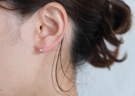 tiny pink S stud pierce