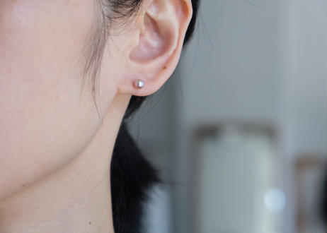 tiny pink S stud pierce