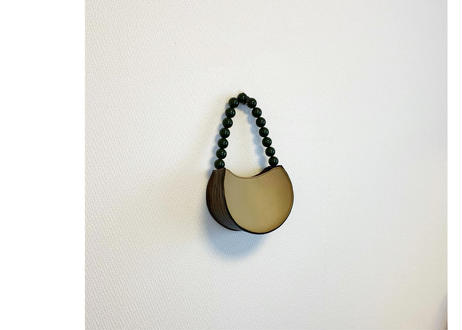 Ball shaped handle bag