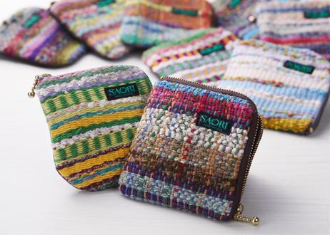 変わり糸を編み込んだ空想庭園織り×本革(子牛)の小物入れ
