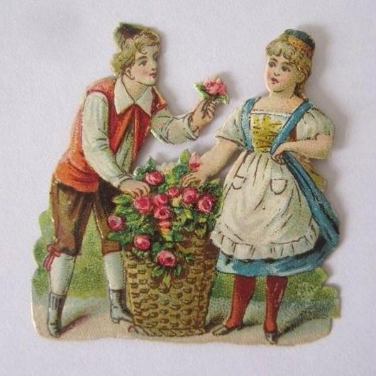 薔薇を贈る男の子と贈られる女の子