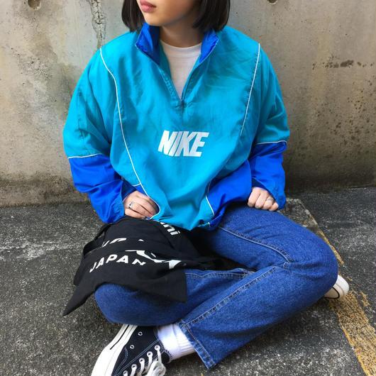 Nike sky blue half zip nylon jacket
