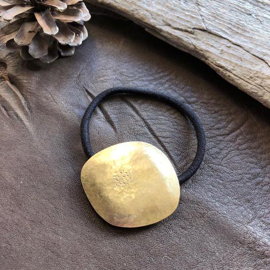 brass flower hair accessory