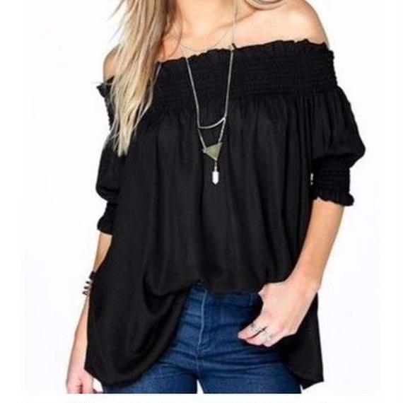 Off-shoulder blouse . Black
