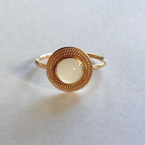 18ct gold Saturn Ring/white Ethiopian opal