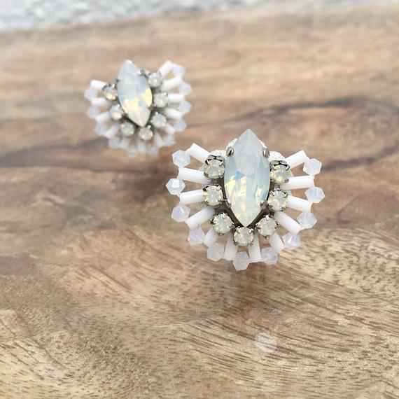 Peacock earring in white