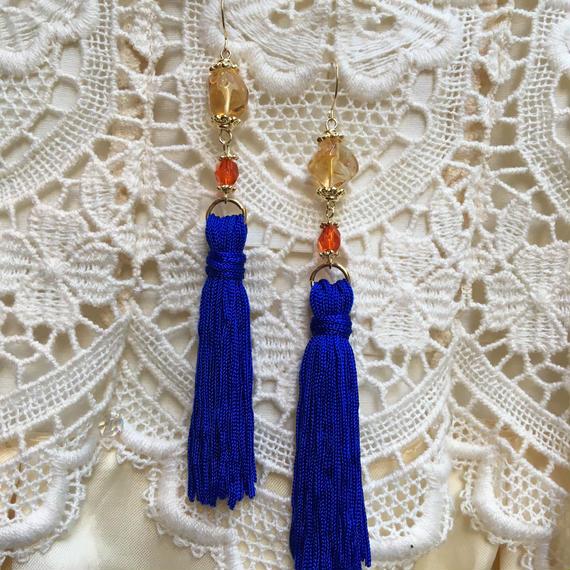 Vintage Amber & OrangeStone with Blue Tassel by freaque