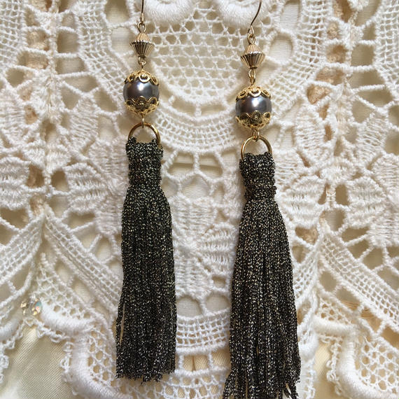 Vintage Black Pearl with Gold Tassel by freaque