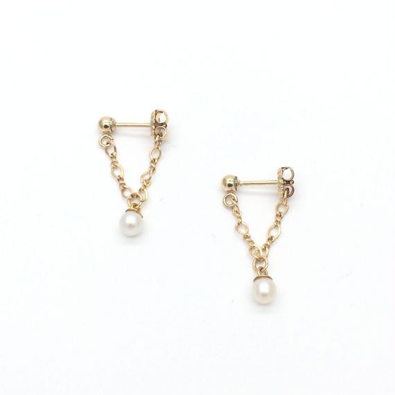 Tiny pearl pierced