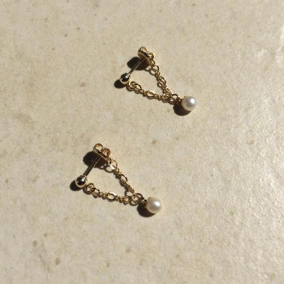 Tiny pearl drop pierced