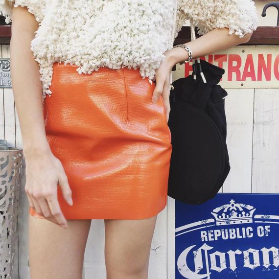 Enamel tight mini-skirt