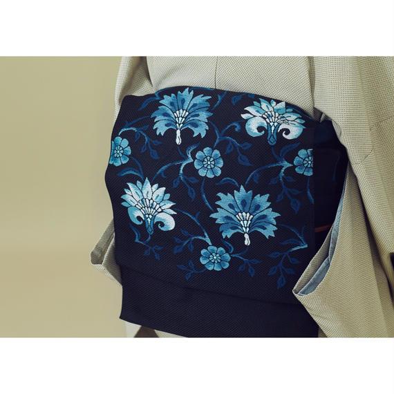 名古屋帯 博多 百合更紗 黒に藍