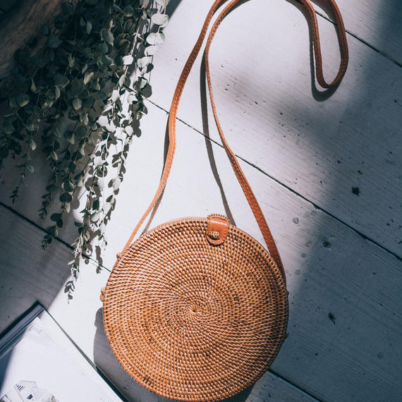 The Gypsea Round Straw Shoulder Bag