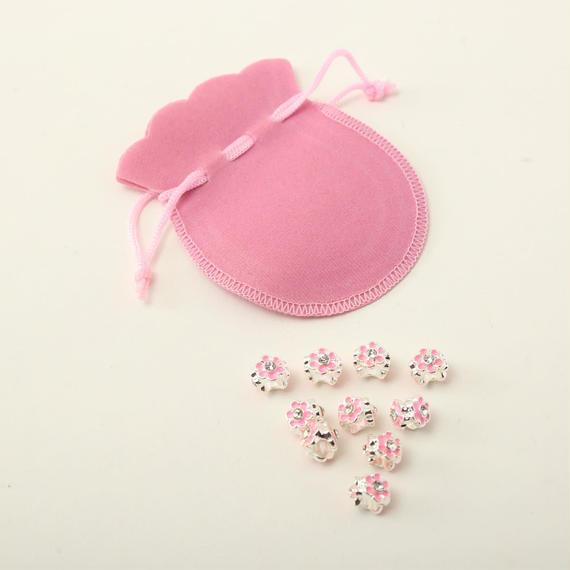 ピンクのエナメルのラインストーン入り花形ビーズ (シルバープレート) 10個と、ピンクの巾着のセット No.28 (B322)