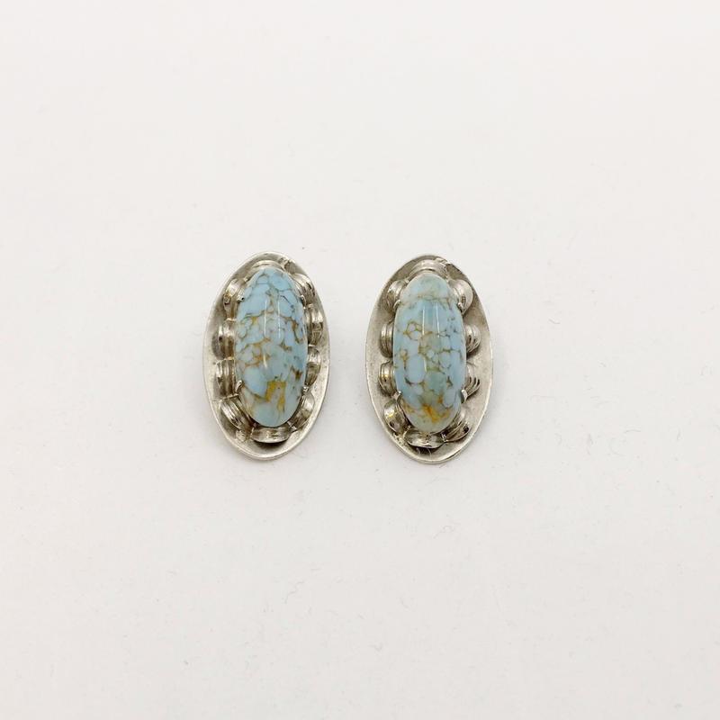 used stone earring