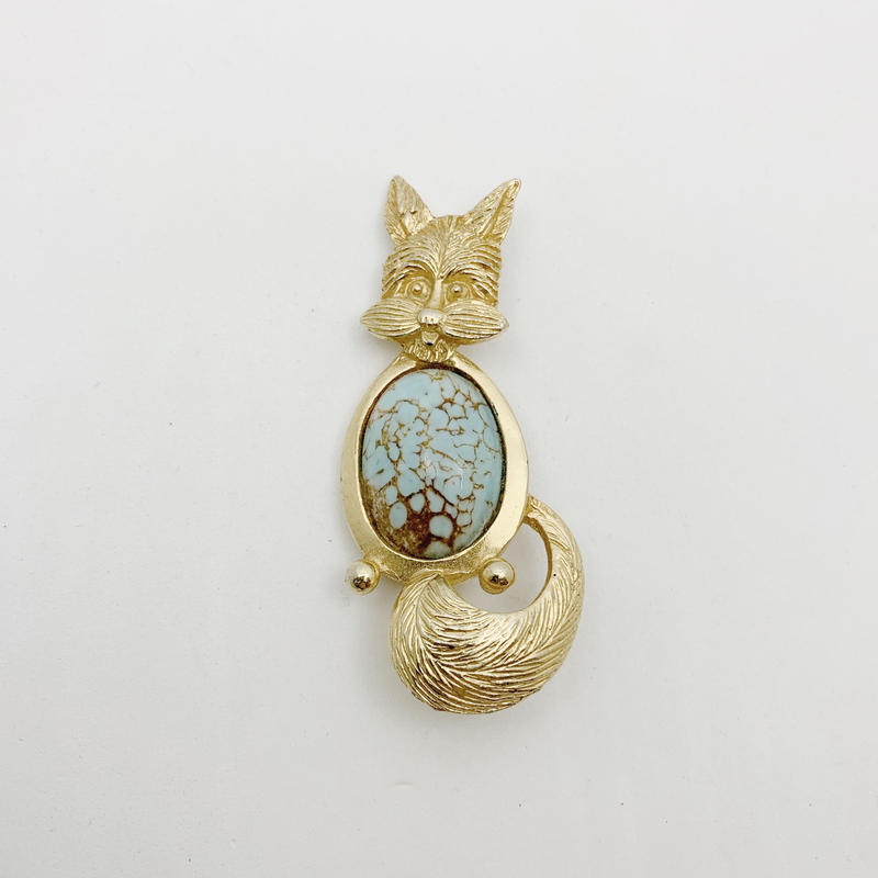 used gold broach
