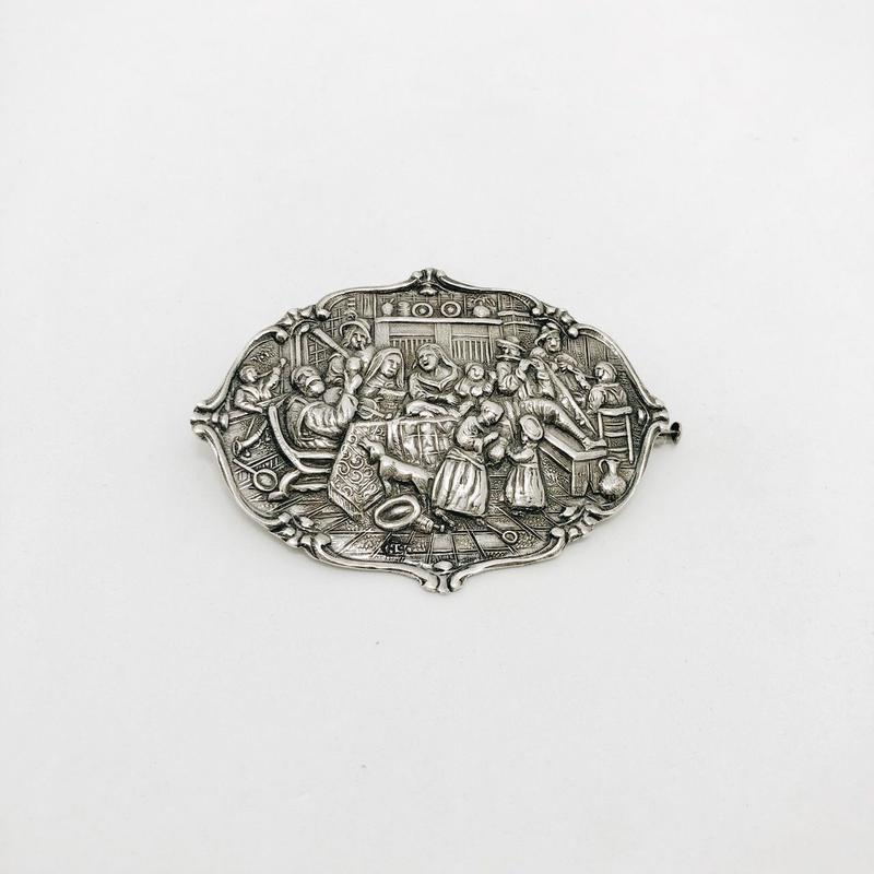 used silver brooch