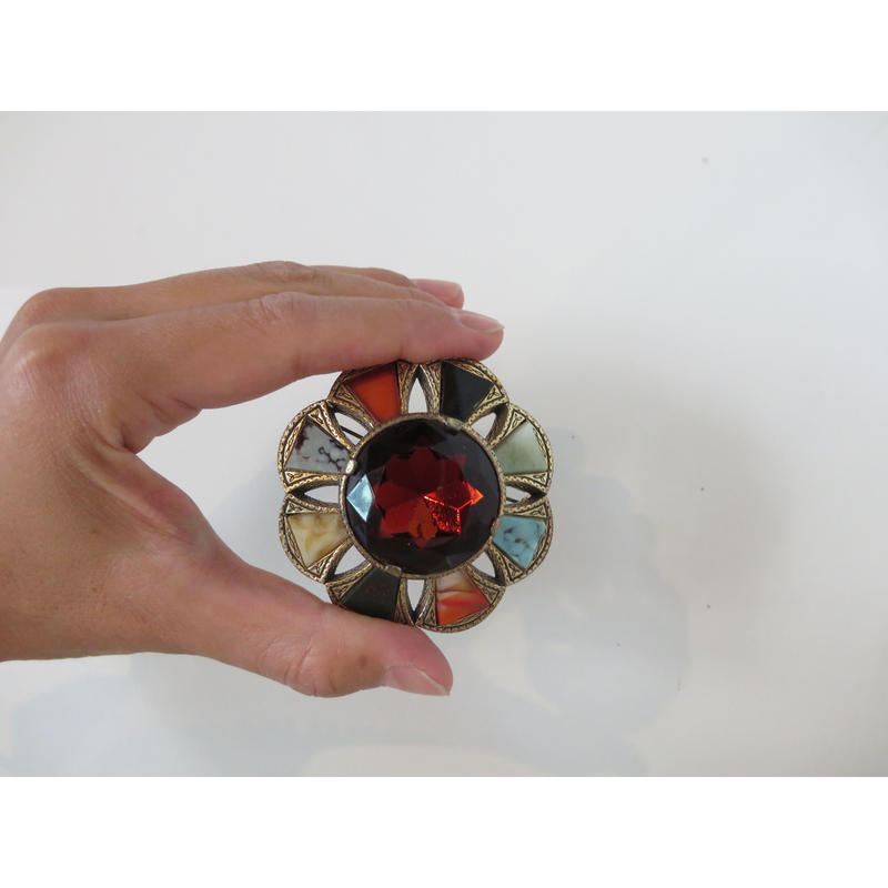 vintage brooch decorated with stones