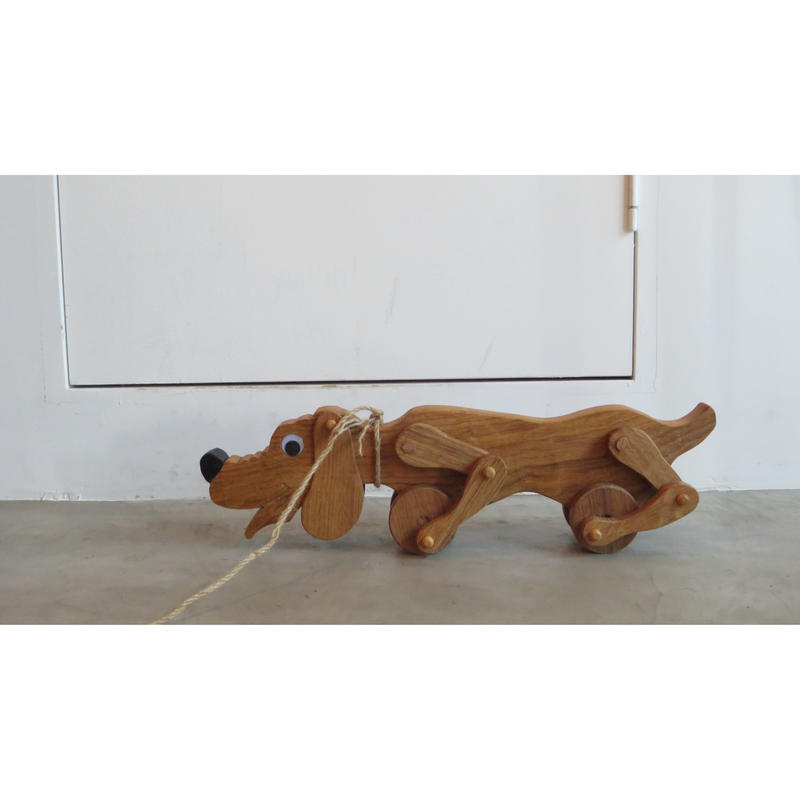 wooden pull toy dog