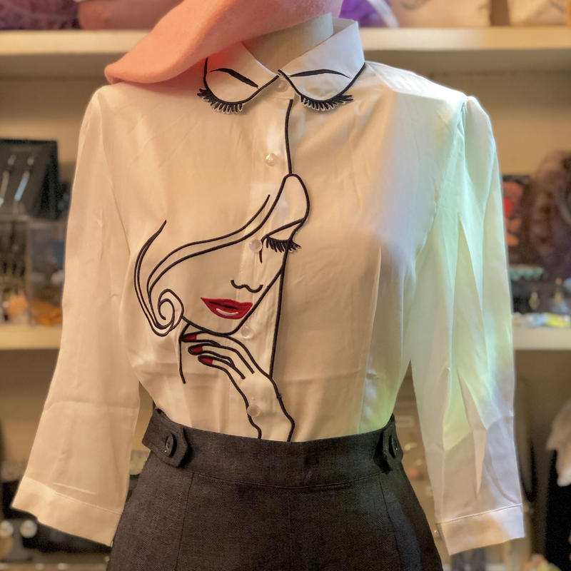 Banned apparel face embroidery blouse