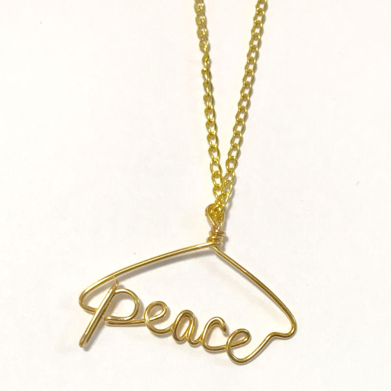 Peace necklace by Kay style jewelry