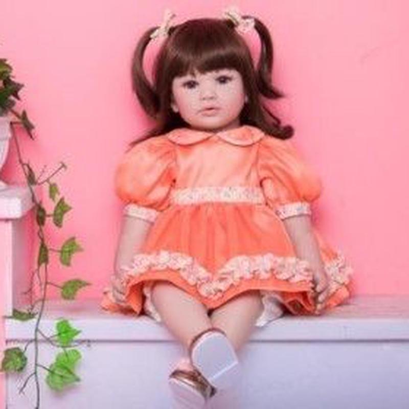 リボーンドール プリンセスドール トドラードール 抱き人形 赤ちゃん人形 ベビードール ハンドメイド リアル 高級 服 衣装付き かわいい オレンジのフリルドレスの女の子