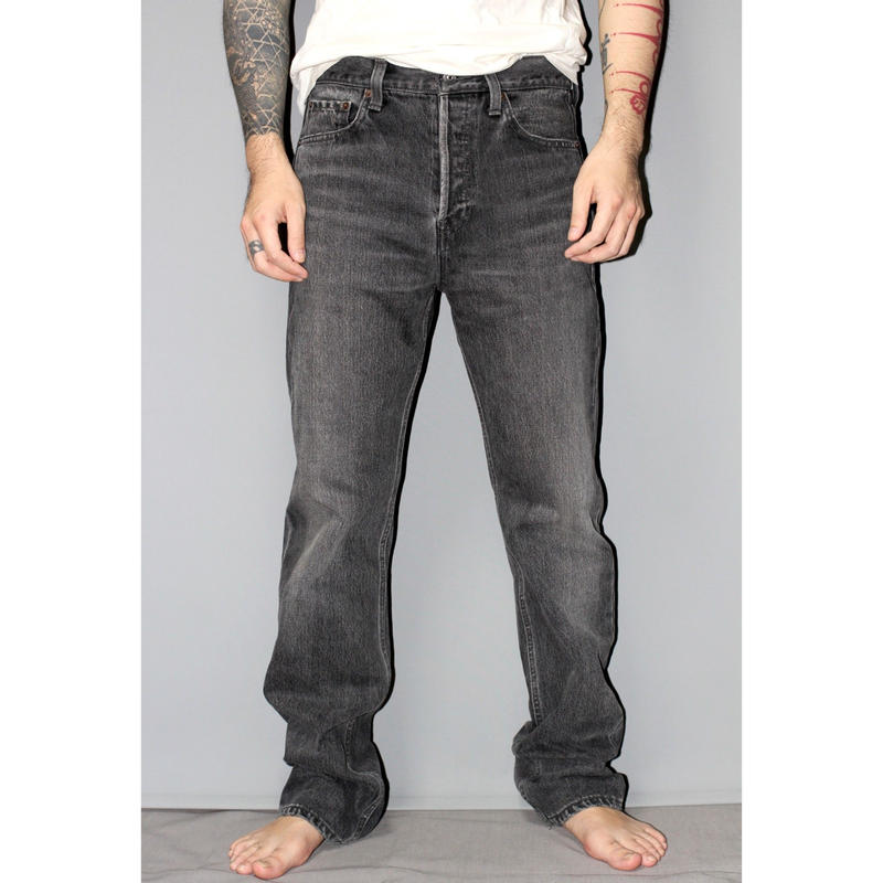 BALENCIAGA / Washed denim jeans