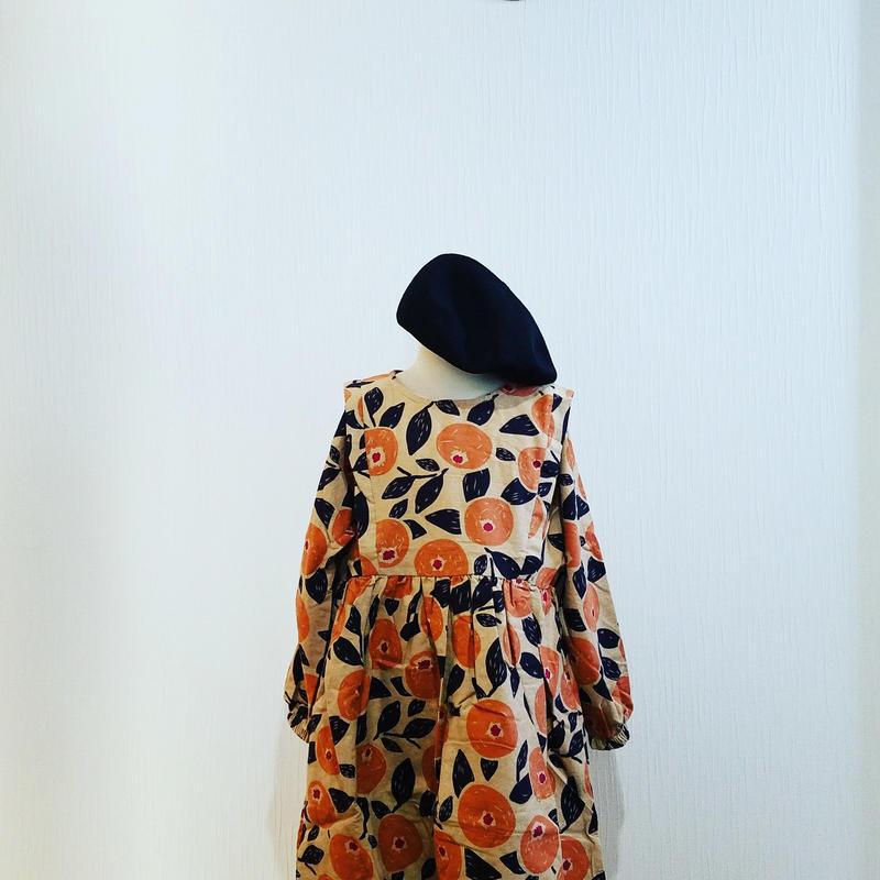 丸いお花がたくさん描かれたワンピース オレンジ
