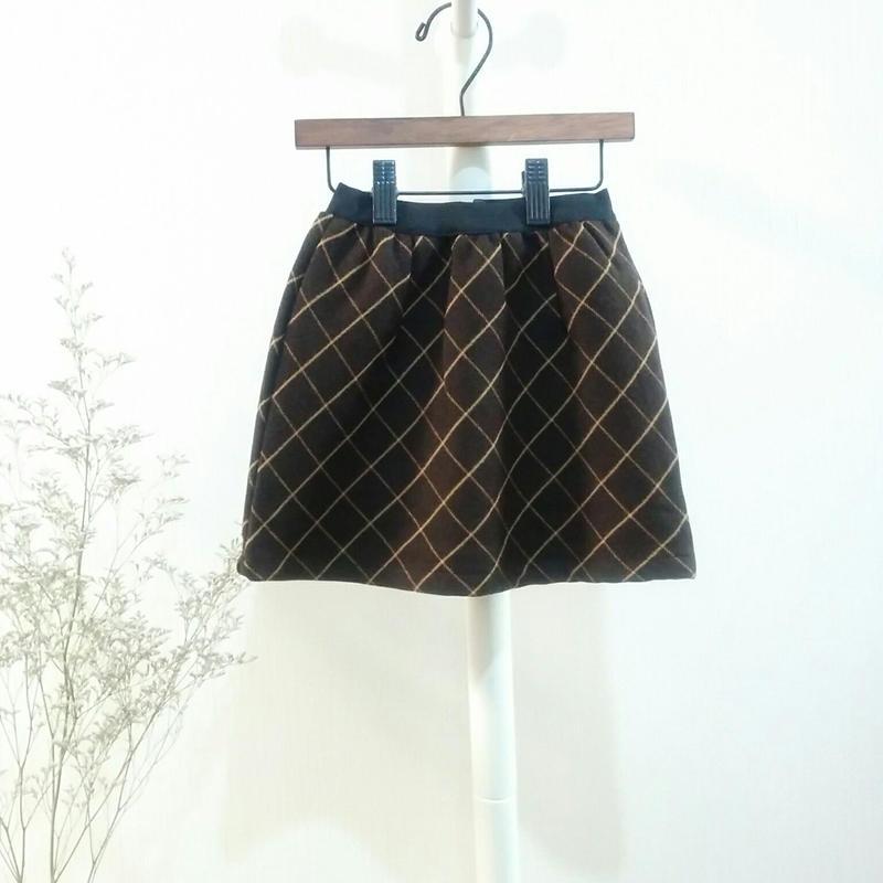 交差するチェックのスカート ANNA OLIVE 茶系