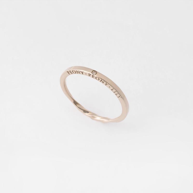 stone puzzle ring / brown diamond
