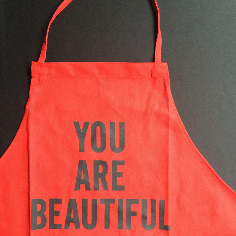 "DRESSSEN DR(RED) 12 ""YOU ARE BEAUTIFUL"" APRON RED COLOR"