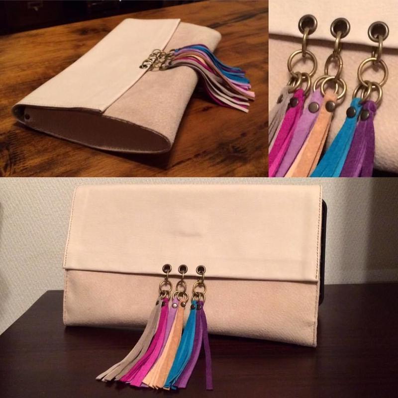 Clutch bag with fringe