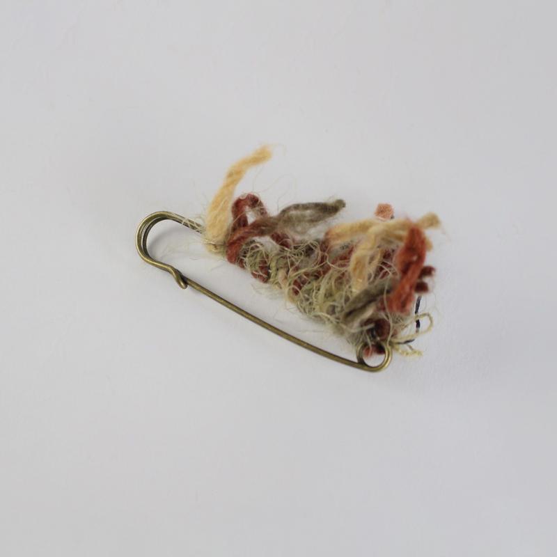 hand-yarn tassel pin brooch