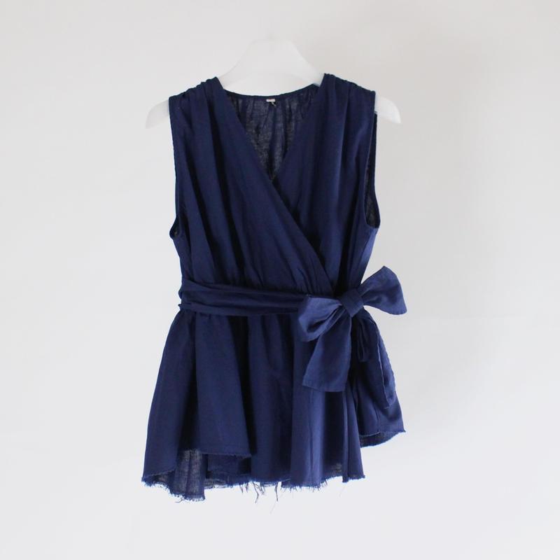 blue cut sleeveless shirt
