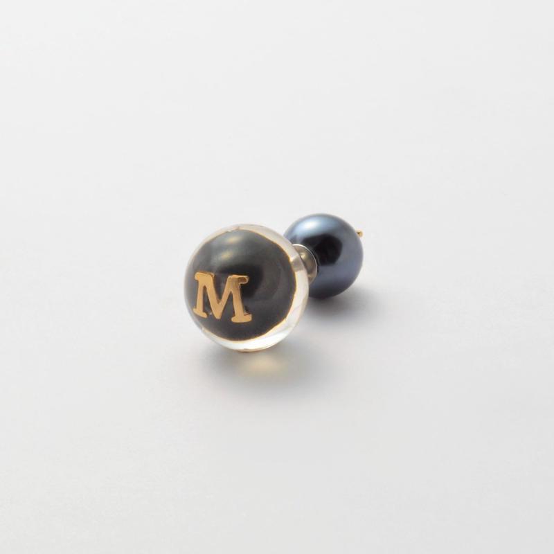 "Initial pierce black ""M"""