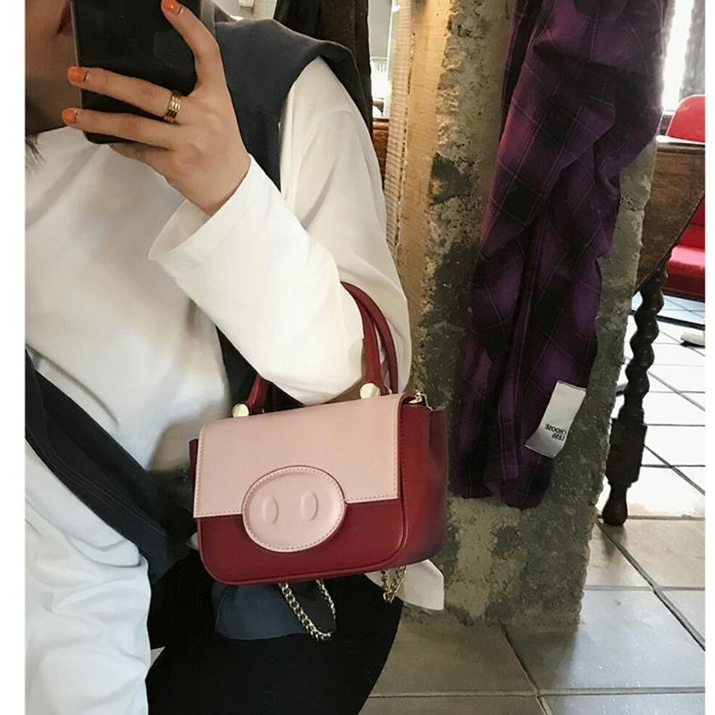 豚鼻がかわいい黒/黄色/ピンクコンパクトハンドバッグ
