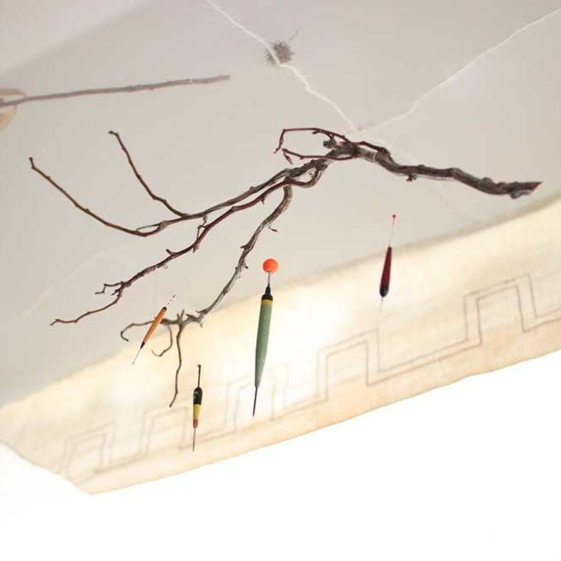 branch mobile with fishing float