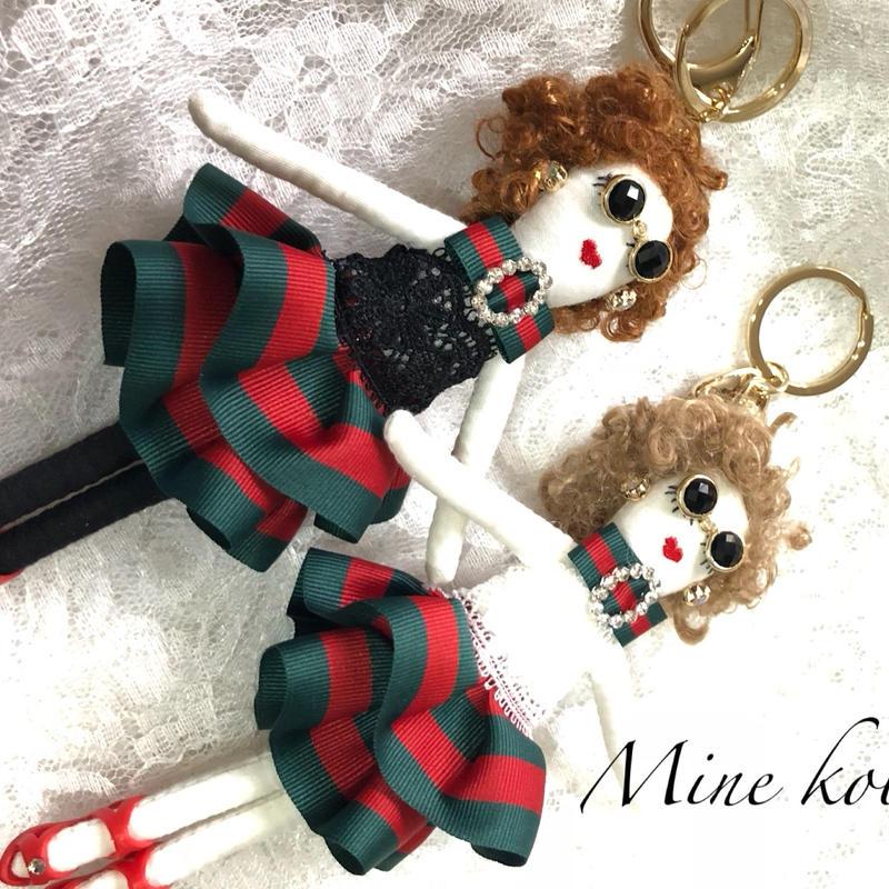 green red ribbon girl doll charm