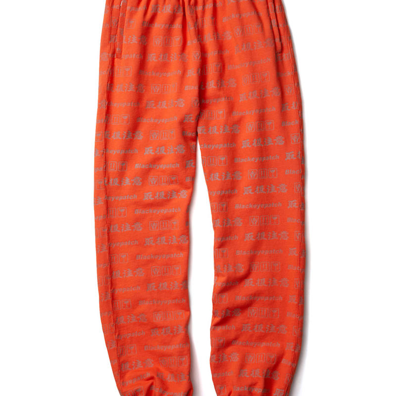 BLACK EYE PATCH HANDLE WITH CARE SWEAT PANTS ORANGE