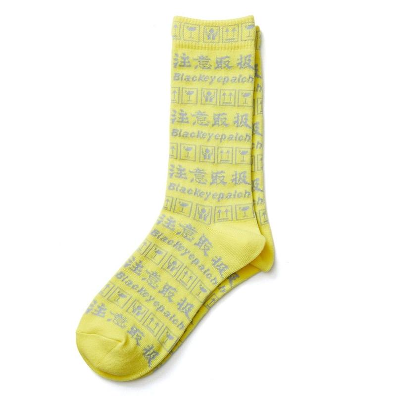 BLACK EYE PATCH HANDLE WITH CARE SOCKS YELLOW