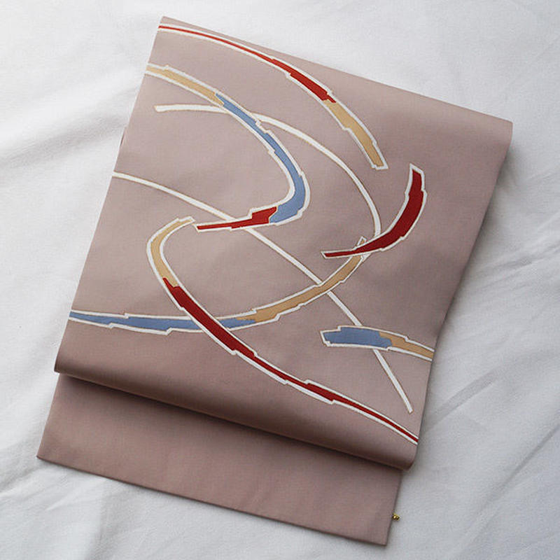 【なごや帯】ピンクベージュ地に抽象文塩瀬なごや帯