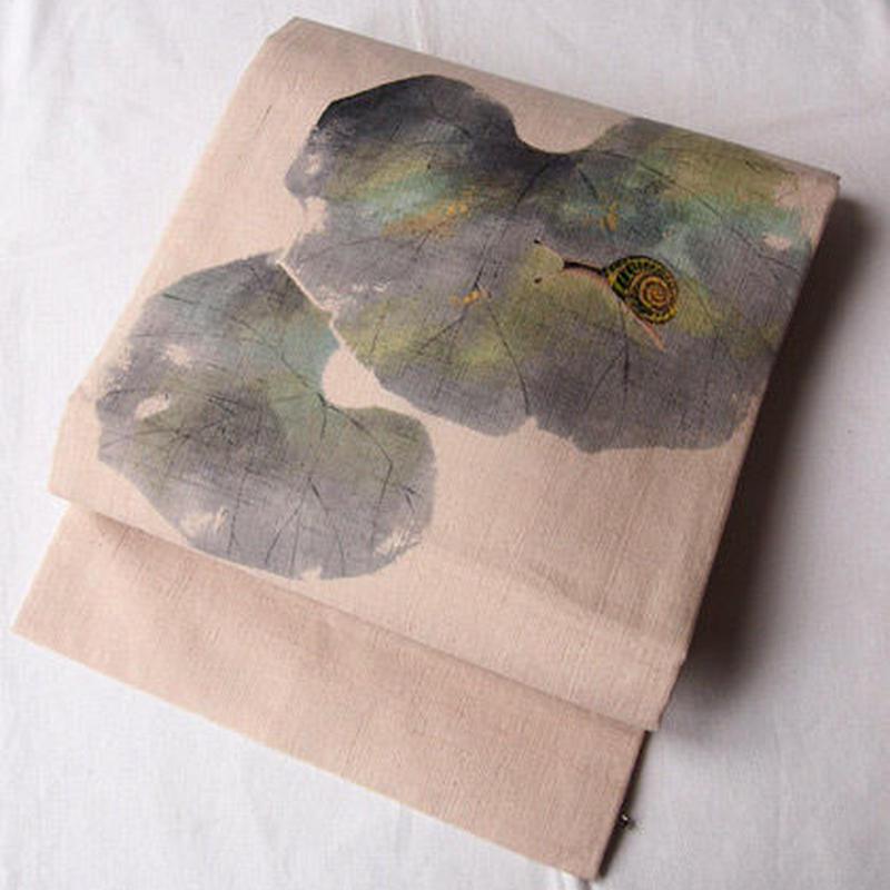 【なごや帯】生成り紬地 手描き つわぶきに蝸牛文 名古屋帯