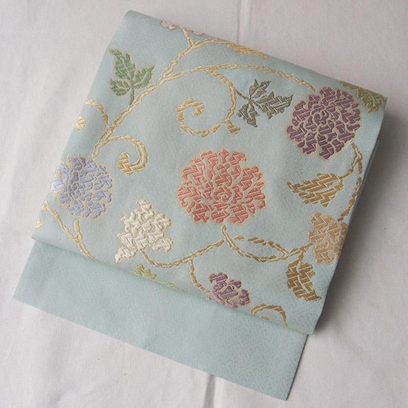 【なごや帯】水色地 パステルトーンの更紗文 唐織り なごや帯