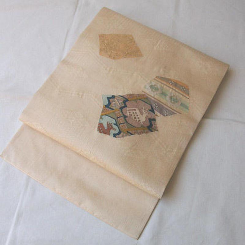【なごや帯】鳥の子色地 織文 名古屋帯