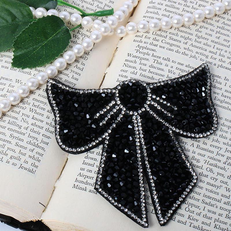 【pour Mademoiselle】ラインストーンリボンブローチ ブラック