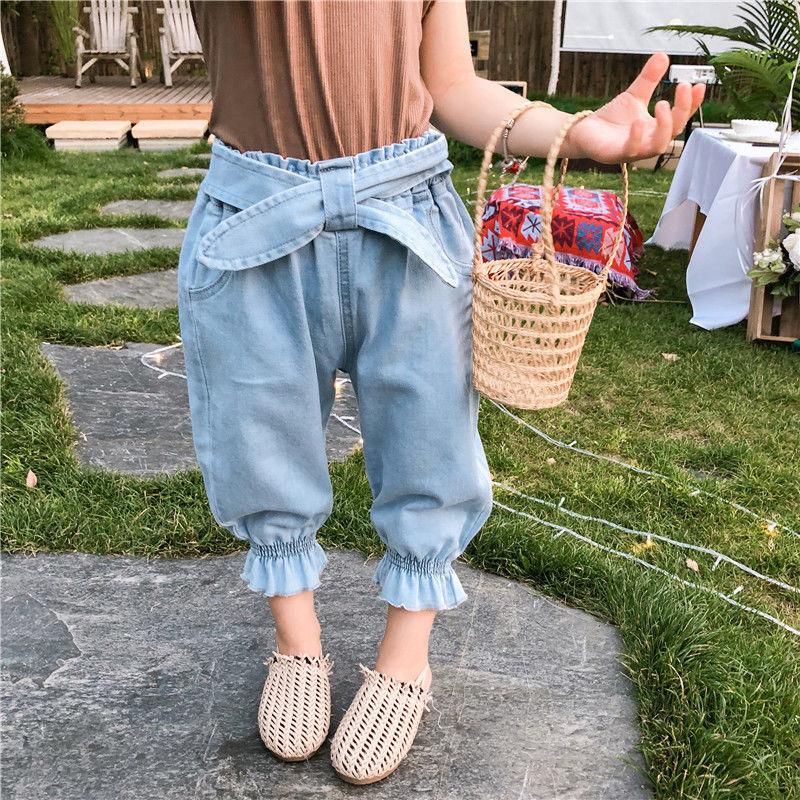 裾絞りデニムパンツ