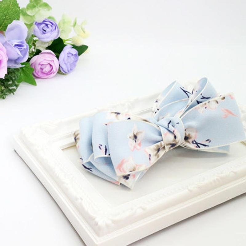 ふんわり柔らか花柄リボンのバナナクリップ(水色)ban058