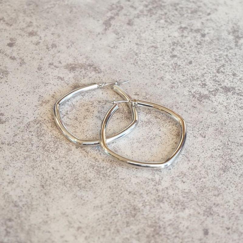 silver hoop pierce