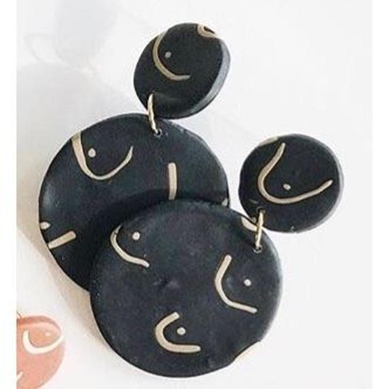 Black Breast Earrings
